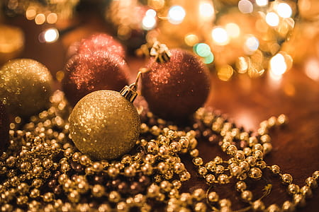 selective focus photo of gold baubles