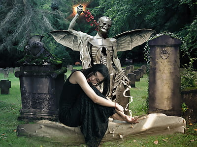 photo of woman sitting beside winged skeleton tomb