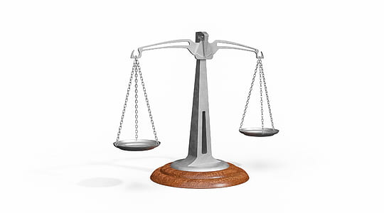 gray and brown balance scale