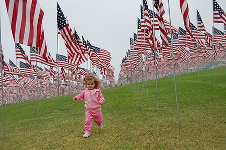 girl running near USA flag lot