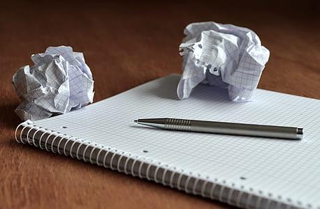 gray click pen on notebook