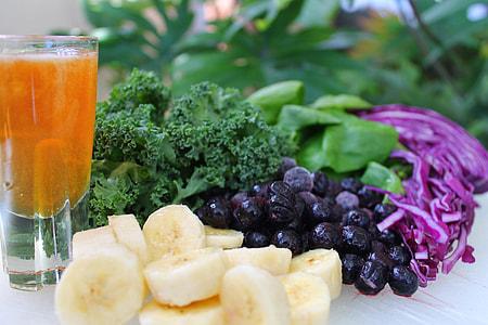 close up photo of slice banana, grapes, and broccoli