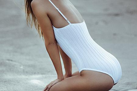 Woman dressed in bikini lingerie on the beach