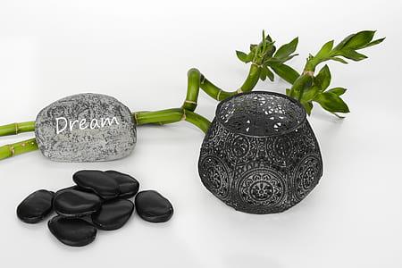 black polished stones and glass vase