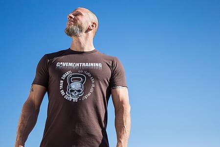 man in black crew-neck t-shirt under blue sky during daytime