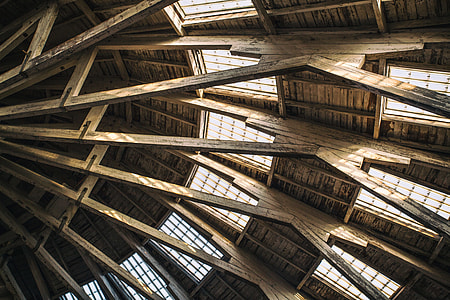 Architectural details from the roof of a wooden building at Chatham Historic Dockyard in Kent, England