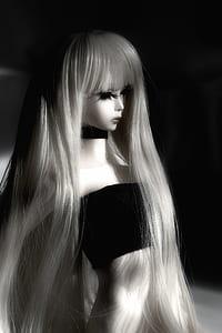 grayscale photo of doll wears black tube shirt