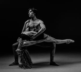 grayscale photo of dancing man and woman