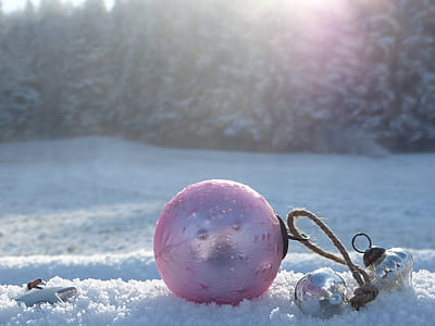 pink ball on snowfield