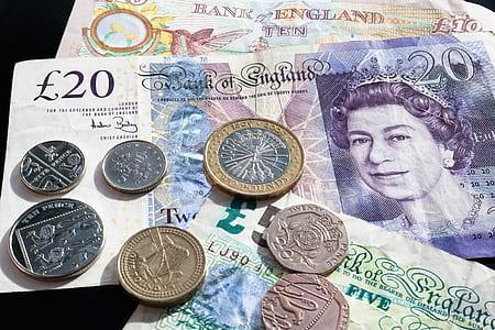 closeup of British coin pound banknotes