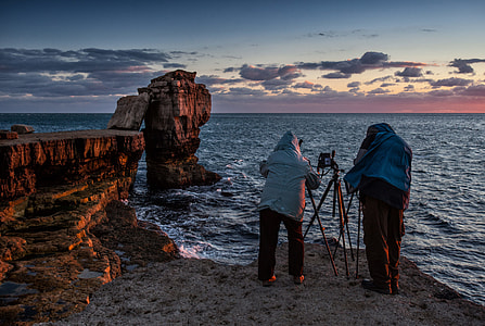 Two photographers make the most of golden hour on the spectacular Jurassic Coast in Dorset, England