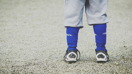 person wearing blue socks and black-and-white shoes
