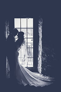 silhouette of couple beside clear glass door