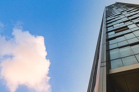 Glass Skyscraper Building and Clouds