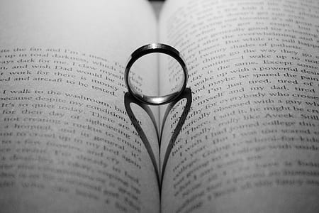 silver-colored ring in the middle of book page center