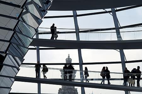 people standing near glass window