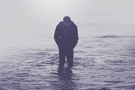 A man standing in the ocean water