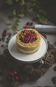 plate of sans rival cake with fruits on top