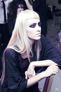 woman with eyeliner sitting on chair