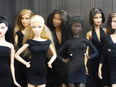 photography of dolls in black dresses
