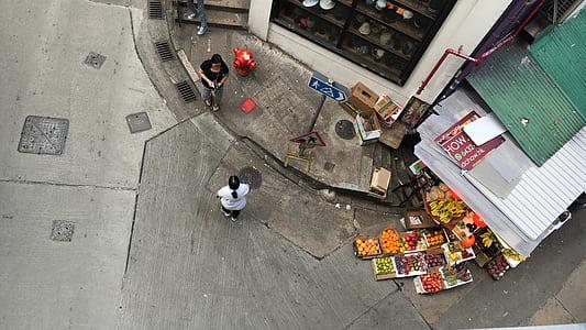 street photography, market, fruit stand, street corner, people