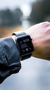 black Apple Watch with sports band