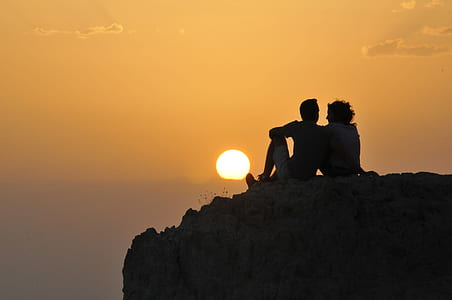 two person on cliff