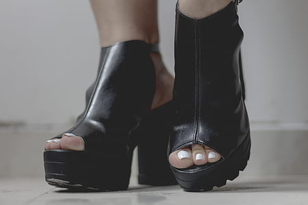 Person Wearing Black Platform Chunky Heels