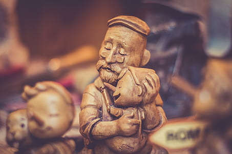 shallow focus photography of Pinocchio carving