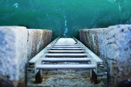 Overhead shot of a ladder leading into the ocean water