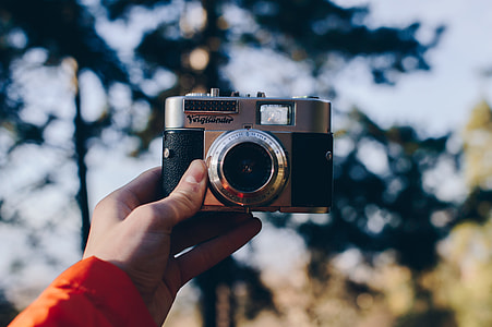 shallow focus photo of digital camera