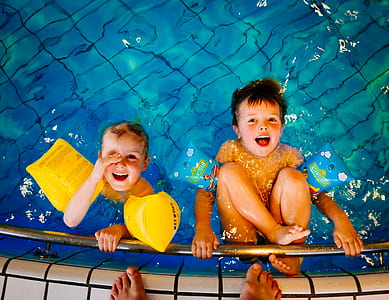 two toddler's on pool smiling