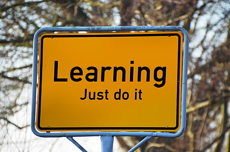 black and yellow learning just do it signage