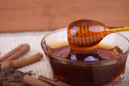 honey in clear glass bowl