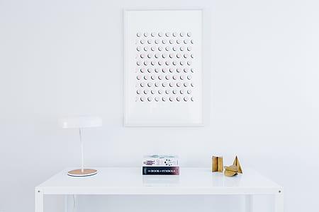 desk lamp on table beside white box