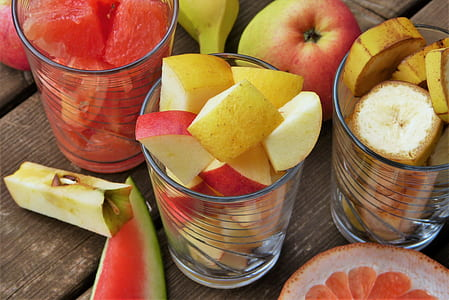 assorted fruits on glass cup