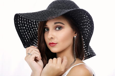 woman wearing black sun hat