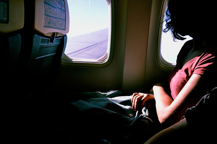 Royalty Free Photo Woman Wearing Red T Shirt Inside Airplane