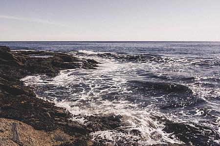 blue sea near rocks