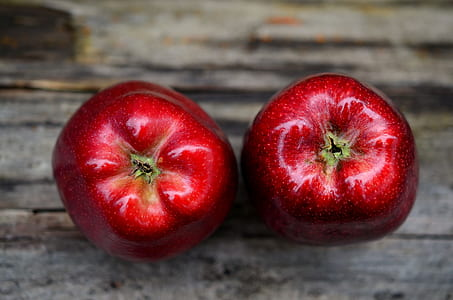 two red unripe apples