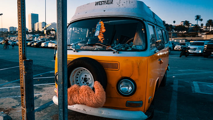 white and orange bus parked at parking space