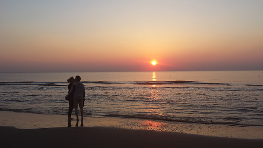 couple at seashore during golden hour