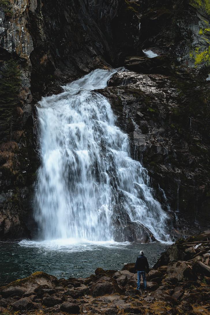 photo of waterfalls near rock mountain