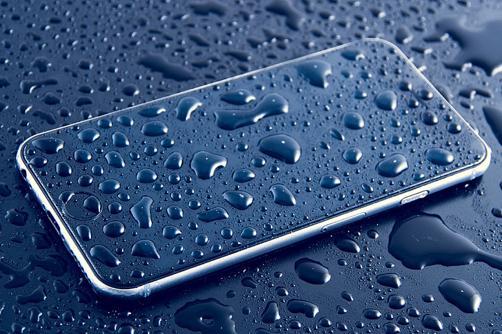 Wet mobile iPhone smartphone with water drops