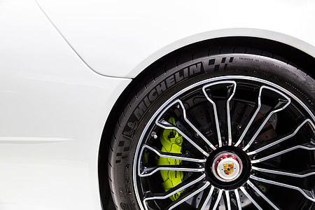 Closeup shot of the alloy wheel of a Porsche racing sports car