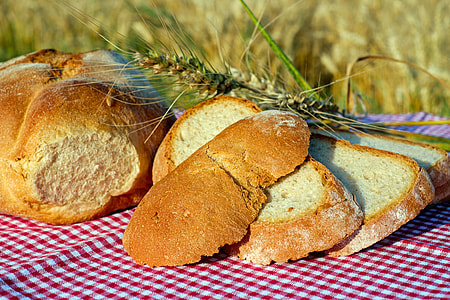 baked bread on red textile