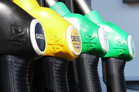 four assorted-colored fuel pump nozzles