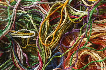 close-up of assorted-color threads
