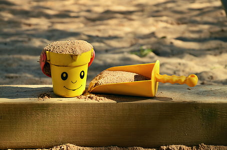 yellow bucket and trowel toys