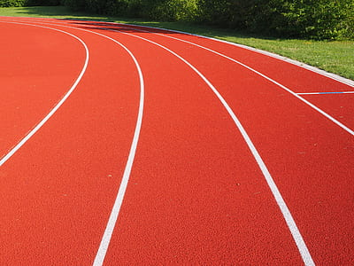 red and white track field during day time